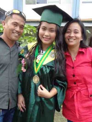 Geraldine Gorre with parents.