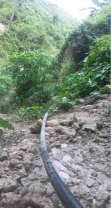 This diversion pipe conduct water from a natural stream to an impounding tank.