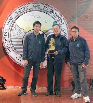 "Safety Award. SEDC operations manager Delfin A. Campo, flanked here by his two assistants, carries the ""Safest Quarry Operations"" award from the Philippine Mine Safety and Environment Association."