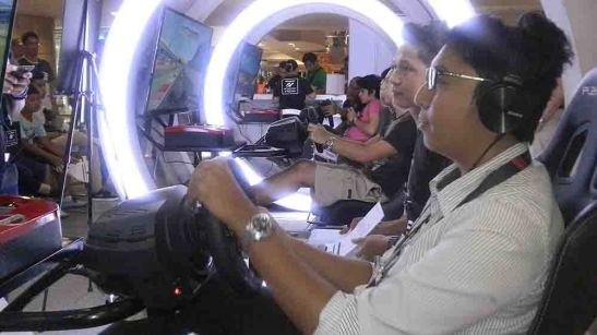 MyTV creative director Nath Ybanez, who joined the June 12 Nissan Ride & Drive event, try out for the Nissan GT Academy at SM City Cebu. The search for the next Nissan professional race car drivers from among video gamers continues until today, June 15, at the SM rotunda.
