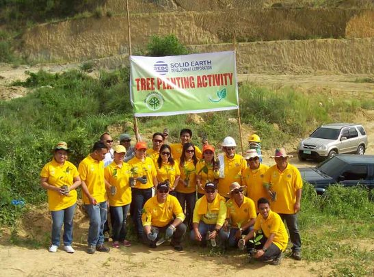 Sustainability. SEDC employees rehabilitate mined out areas in the hills of Magsico in San Fernando, Cebu by planting 2,400 trees.