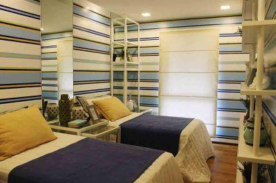 Amalfi. A look inside the bedroom of a model unit.