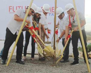 Lapu-Lapu City tourism officer Hembler Mendoza (3rd from right) helps lay the time capsule to start the construction of the new Filinvest subdivision.