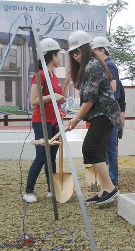 JVC EVP Norma Lim seals the time capsule during the groundbreaking last year.
