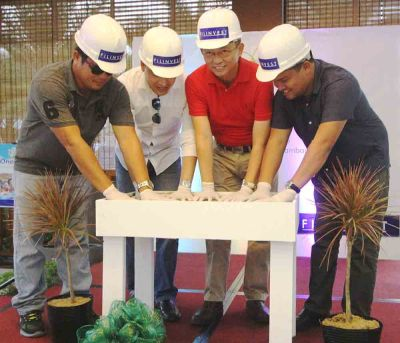 First concrete. Leading the rites are, from left: Eng'r. Freddie Serrano of contractor Longridge Construction, Inc., FLI AVP for sales Boler L. Binamira, VP / AGM Eng'r. Allan Go Alfon and Archie M. Igot, project development officer managing the project.