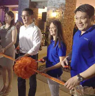 "Inauguration. Cebuano actor Richard Yap (centert), brand ambassador of Filinvest Land, Inc. and ""I Own My Dream"" campaign advocate, leads the inauguration of the clubhouse and complete amenities of Sanremo Oasis. With him are (from left) FLI senior manager for project development Julie R. Castaños, VP for group real estate marketing Bernadette M. Ramos, and Tristan Las Marias, SVP for the Visayas and Mindanao cluster."