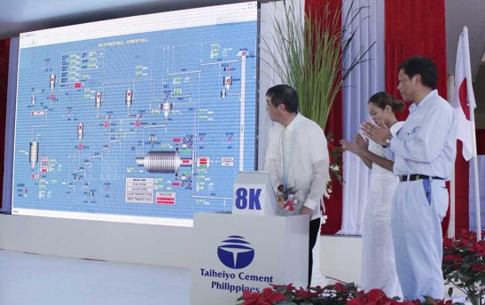 Switching on. Japan-based Taiheiyo Cement Corp. president Shuji Fukuda switches the ceremonial button on to run for commercial operations the eigth cement grinding finish mill of Taiheiyo Cement Philippines, Inc. in San Fernando, Cebu.