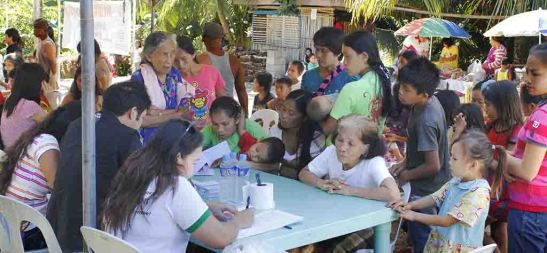 Basak in Care. Volunteers attend to residents of Basak, San Fernando Cebu as the medical mission of Taiheiyo Cement Philippines, Inc. returned to the barangay after four years.