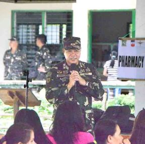Opening. AFP CENTCOM deputy commander B/Gen. Alan R. Arrojado welcomes Sevilla residents and the volunteers.