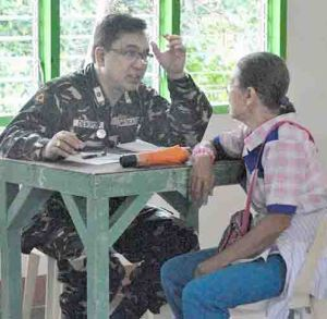 Consultation. An Army reservist doctor attends to a patient.