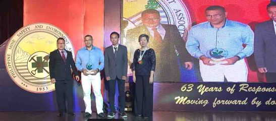 Best Mining Forest. SEDC community relations officer Gines T. Boltron (center left) receives with SEDC quality analyst Roque Louie M. Israel (center right) the 2016 Best Mining Forest Award from MGB chief of Mine Safety, Environment and Social Development Division Rodolfo L. Velasco, Jr. (extreme left) and PMSEA assistant treasurer Annie G. Dee (extreme right).