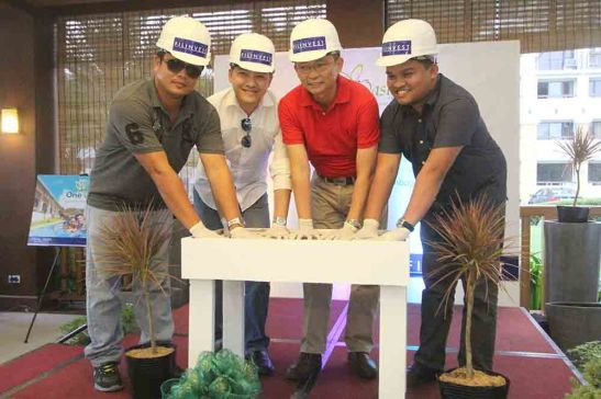 First concrete. Filinvest Land, Inc (FLI) holds the first concrete pouring ceremony for the fifth building at One Oasis Cebu, a resort-themed enclave of mid-rise condominiums in Kasambagan, Cebu City. Photo shows, from left: Eng'r. Freddie Serrano of contractor Longridge Construction, Inc., FLI AVP for sales Boler L. Binamira, VP and area general manager Eng'r. Allan Go Alfon and Archie M. Igot, project development officer managing the project.