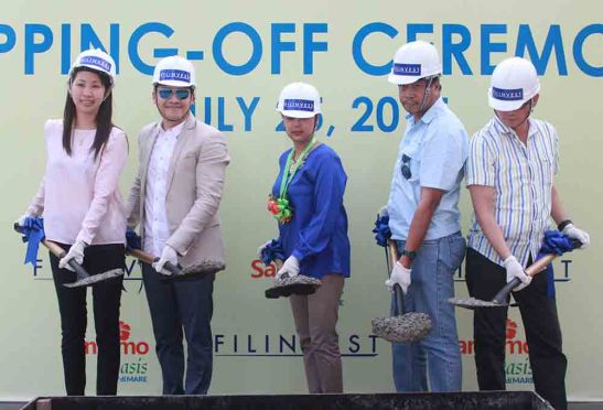 Topping Off. Philippine Retirement Authority (PRA) marketing manager Noehl D. Bautista (center) joins Filinvest Land, Inc. officials in topping-off the 6th building at Sanremo Oasis, a resort-inspired enclave of mid-rise condominiums at South Road Properties. They are, from left: project development officer project development officer project development officer project development officer Julie R. Castaños, AVP sales head Boler L. Binamira, the contractor's representative, and VP/GM Allan Go Alfon.