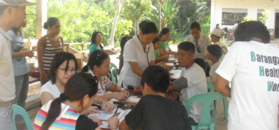 Medical Mission. Employees of Taiheiyo Cement Philippines, Inc. and Solid Earth Development Corp. and volunteers attend to San Fernando hillsfolk.