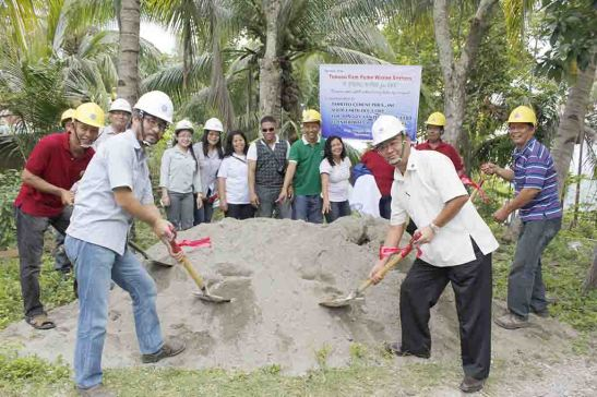 Water Project. SEDC director Takehito Oga (left) and Takahiko Imachi (right), then TCPI SVP for Marketing and HRA, lead the groundbreaking for the hydraulic ram pump water system for residents of Tonggo, San Fernando. The gravity-fed system has after 75 days served the water requirements of the hillsfolk.