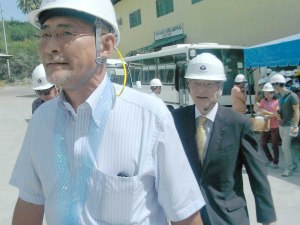 TAIHEIYO officials from Japan inspect the new TCPI 8K finish mill during its inauguration.